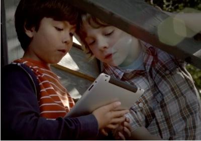 Two kids using an iPad