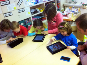 Kids using iPads in school