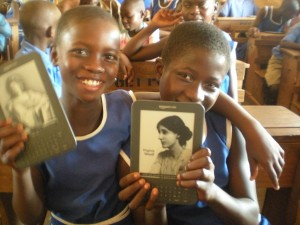 Ugandan schoolchildren with Amazon Kindle e-readers provided by Worldreader, a Seattle-based nonprofit