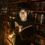Aaron Swartz with illuminated book in bookstore
