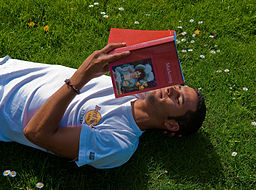 man reading on grass
