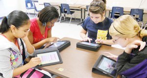STEM-students-using-iPads-300x182.jpg